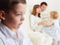 Children's jealousy. Boy is jealous parents of younger sister Royalty Free Stock Photo