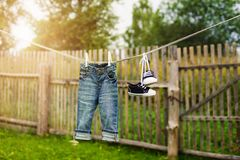 Children's jeans and sneakers Royalty Free Stock Photos