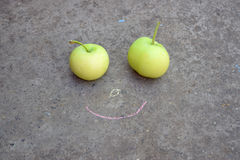 Children's joke. Drawing for Mom. Smile and green apples. Stock Images
