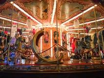 children& x27; s-karusellbarndom Arkivfoton