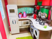 Children`s kitchen, kindergarten and toys for children. Small kitchen. Miniature cooking area royalty free stock photo