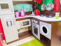 Children`s kitchen, kindergarten and toys for children. Small kitchen. Miniature cooking area royalty free stock photos
