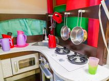 Children`s kitchen, kindergarten and toys for children. Small kitchen. Miniature cooking area stock image