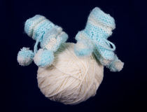 Children's knitted bootees. On the isolated background Royalty Free Stock Photography