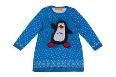 Children`s knitted dress with a penguin. Isolate on white Stock Images