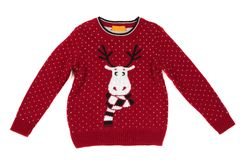 Children`s knitted sweater with a deer pattern. Isolate on white. Background royalty free stock photos
