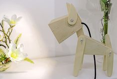 Children`s lamp in the form of a wooden doggie.  stock images