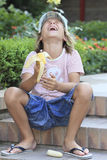 Children's laughter. Boy dropped his banana and the laughs Stock Photos