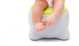Children's legs. Hanging down from a chamber-pot Stock Photo