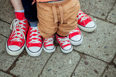 Children's legs and feet in  sneakers Stock Photos