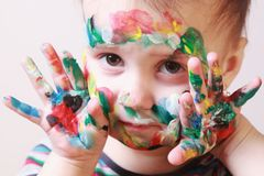 Children`s make-up humorous picture. Beautiful  little baby girl doing make up humorous picture Royalty Free Stock Image