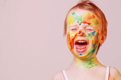 Children`s make-up, portrait of happy baby girl humorous pictur. E Royalty Free Stock Photo