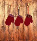 Children`s mittens on a wooden background. Pending gifts. Childh royalty free stock photography