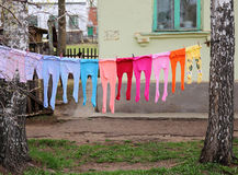 Children's multi-colored tights. Laundered children's colored tights drying on the street Stock Images