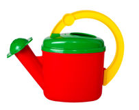 Children's multicolored watering can, isolated Royalty Free Stock Images