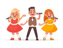 Children`s musical trio. A boy and a girls are singing a song on Royalty Free Stock Images