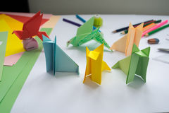 Children's  origami  wolf's and bird's from colored paper. Royalty Free Stock Images