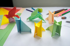 Children's  origami  wolf's and bird's from colored paper. Royalty Free Stock Photo