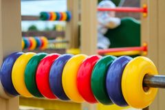 Children`s outdoor gaming complex with colored rings bills for small kids. Selective focus and limited depth of field Stock Image