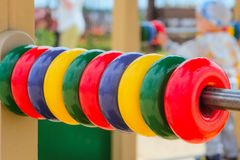 Children`s outdoor gaming complex with colored rings bills for small kids. Selective focus and limited depth of field. Kid playing in the blurred background Stock Images