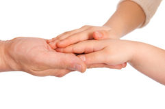 Children's palms in a reliable man's hand. On white stock photos
