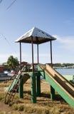 Children's park slide Brig Bay Corn Island. Old fashioned slide ride children's park waterfront Brig Bay Corn Island Nicaragua stock images