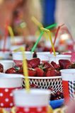 Childrens Party. Childrens holiday table with lemonade and fresh strawberries and cherries Stock Images