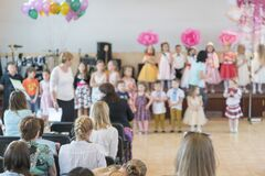 Free Children`s Party In Primary School. Young Children On Stage In Kindergarten Appear In Front Parents. Holiday In Kindergarten. Royalty Free Stock Photos - 173370098