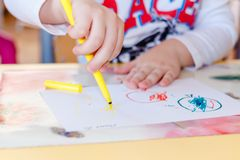 Children`s pens are drawn on paper by markers royalty free stock images