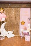 Children`s photo zone with a wooden month with stars and a lot of balloons. Decorations for a One year old Girl's Birthday . Stock Image