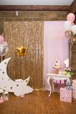 Children`s photo zone with a wooden month with stars and a lot of balloons. Royalty Free Stock Photography