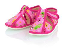 Children`s pink slippers on the white background with shadow reflection. stock images