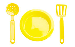 Children's plastic kitchen colander and plate Royalty Free Stock Images