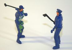 Children`s plastic soldiers, two figures of policemen in uniform with the tool. The picture was taken in close-up. stock photos
