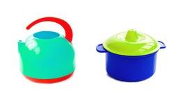 Children's plastic tea maker and pan Stock Photo