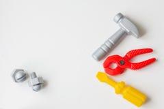 Children`s plastic toy. Children`s tool. hammer, pliers, screwdr Stock Photo