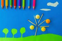 Children's play: apple tree on blue sky. Figurative apple tree on blue sky Royalty Free Stock Image