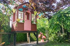 Children`s Play House On Leafy Area Of Garden Royalty Free Stock Photo