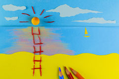 Children's play: Staircase to sun. Staircase leading to the sun on a figurative beach on the sunset Stock Photos