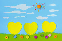 Children's play: yellow harts on blue sky Royalty Free Stock Images