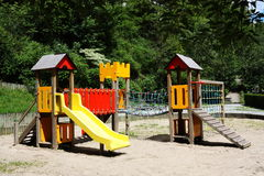 Children's Playground. A colourful children's playground with slide, ramp and climbing ropes and frames, no people Royalty Free Stock Image