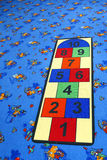 Children's playground. Playground for children with colored carpet with hop-scotch Royalty Free Stock Images