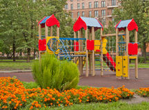 Children's playground. Children playground and a flowerbed in moscow, russia Stock Photography