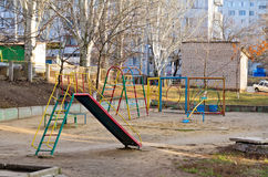 Children's playground. In a house court yard Stock Images