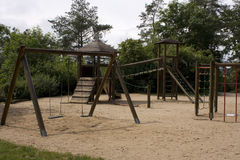 Children's playground. With wooden monkey bars and swing Royalty Free Stock Photo