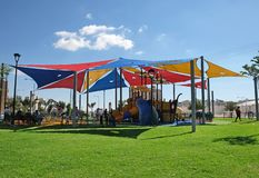 Children`s playground in Beer Sheva. BEER SHEVA, ISRAEL - OCTOBER 27, 2018: New modern playground for children with shading stock photos