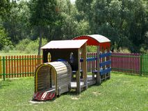 Children's playground. Cheerful children's playground is located in the park Stock Images