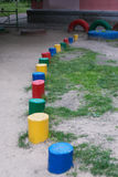 Children's playground. Colored wooden columns on the playground. Selective focus Stock Photos