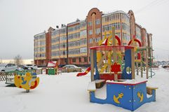 Children`s playground in the courtyard of the apartment building. Russia. Siberia. Winter stock image