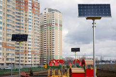 Children's playground in the courtyard of an apartment house with solar panels Stock Photography
